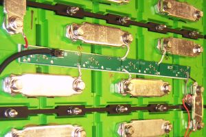 Cell boards mounted on prismatic cells